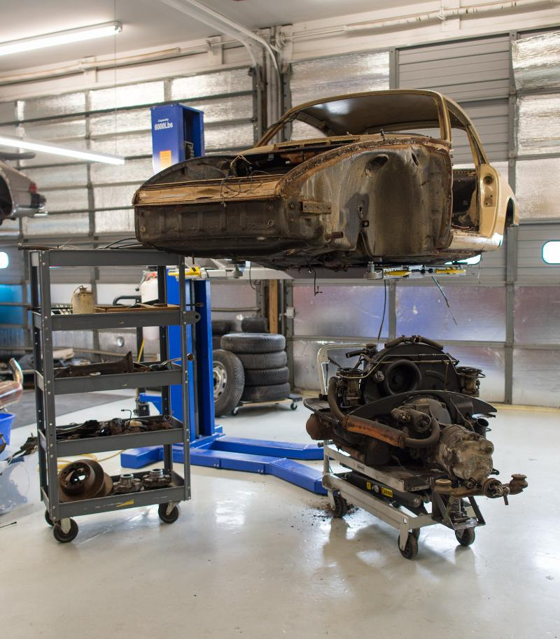 A disassembled porsche. The start of the restoratin process.
