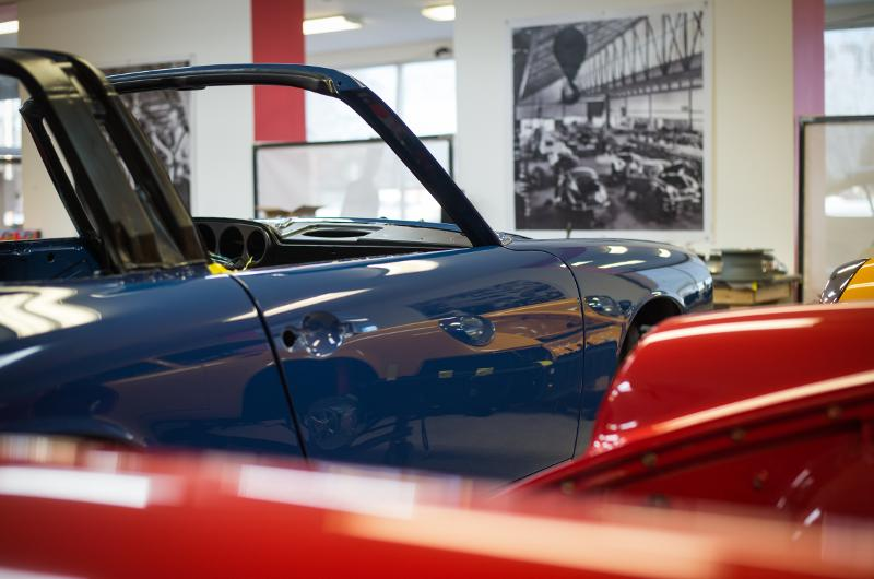 freshly painted porsches in the assembly room