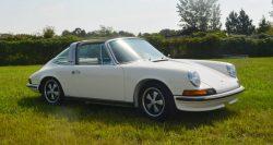 a white 1973 Porsche 911E Targa